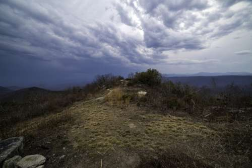 Mound at the Hilltop under lingering storm clouds at Sassafras Mountain, South Carolina free photo