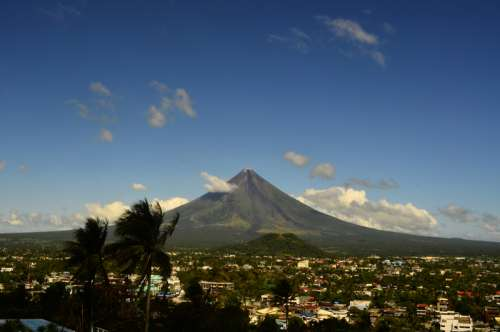 Mountain rising above the landscape of the town in the Philippines free photo