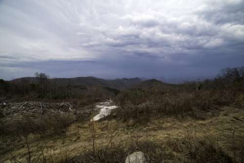 Mountains in the distance in the landscape under rain clouds at Sassafras Mountain free photo