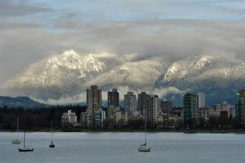Mountains in the landscape behind the skyline of Vancouver, Canada free photo