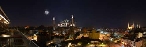 Night Cityscape in Istanbul, Turkey with moon and the Hagia Sophia free photo