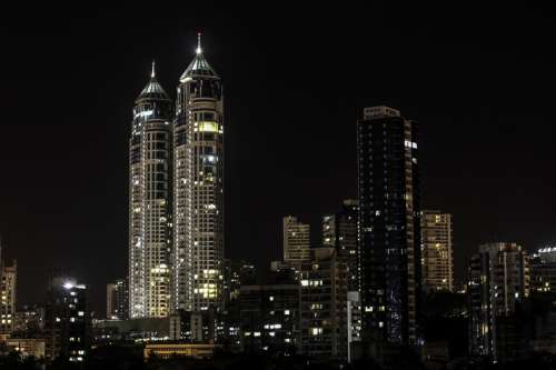 Night skyscrapers with lights in Mumbai, India free photo