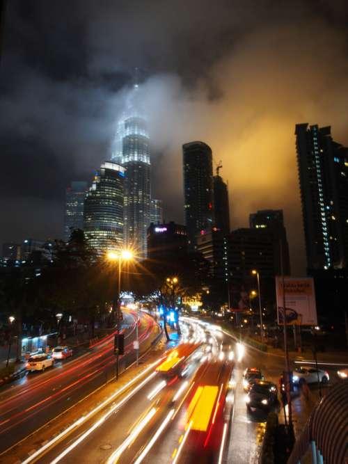 Nighttime tower and streets in Kuala Lumpur, Malaysia free photo