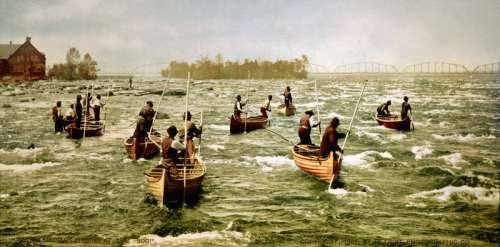 Ojibwe fishermen in the St. Marys Rapids, 1901 in Sault Ste. Marie in Ontario, Canada free photo