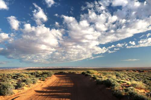 Path under the clouds in Utah near Hanksville free photo