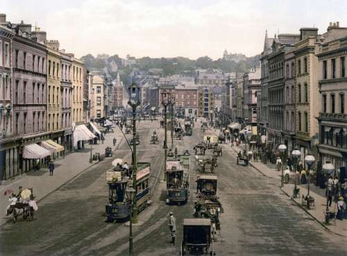 Patrick Street around 1900 with cars and people in Cork, Ireland free photo