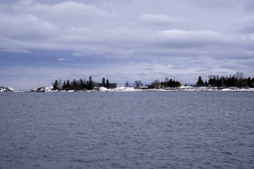 Peninsula with trees and houses on Lake Superior in Grand Marais, Minnesota free photo