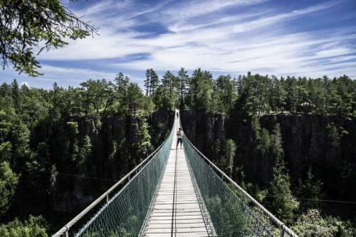 People standing on the long suspension bridge in Eagle Canyon, Ontario free photo