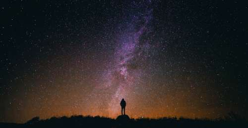 Person standing under the Milky Way free photo