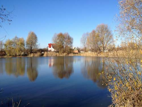 Pond and Houses landscape in Ukraine free photo