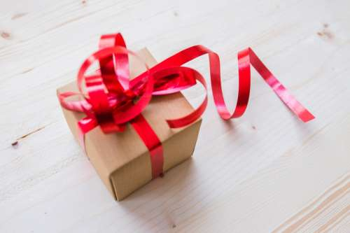 Present Box with Ribbons tied around it free photo