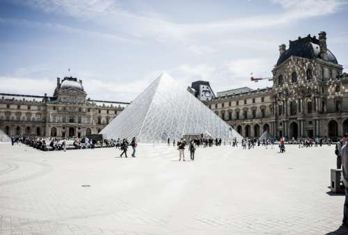 Pyramid of Louvre square in Paris, France free photo