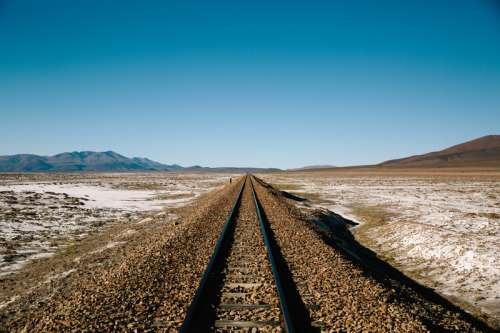 Railroad landscape with horizon and sky free photo