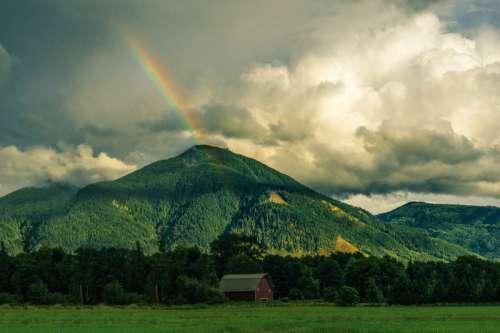 Rainbow behind the Mountain landscape free photo