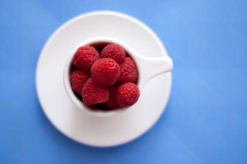Raspberries in a Cup free photo