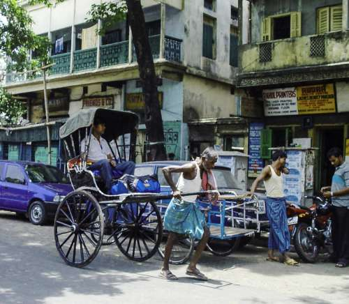 Riksha in the road in Calcutta, India free photo