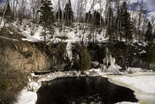 River Banks with Icicles and landscape in the winter at Temperance River State Park, Minnesota free photo