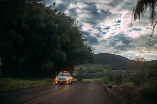 Road with police car in the landscape free photo