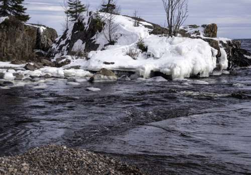 Rock Covered in snow at Temperance River State Park, Minnesota free photo