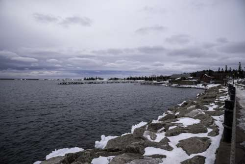 Rocks on the Lake Superior Shoreline in the winter in Grand Marais, Minnesota free photo