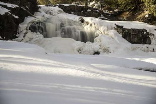 Rushing waterfalls in the snow and ice at Gooseberry Falls State Park, Minnesota free photo
