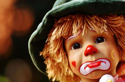 Sad Clown Face on doll free photo