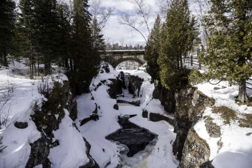 Scenery on the Temperance River flowing towards the bridge at Temperance River State Park, Minnesota free photo