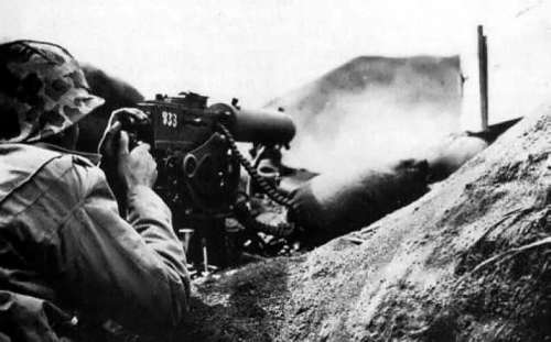 Sherman Tanks using Flamethrowers to clear out Japanese Bunkers at Iwo Jima free photo