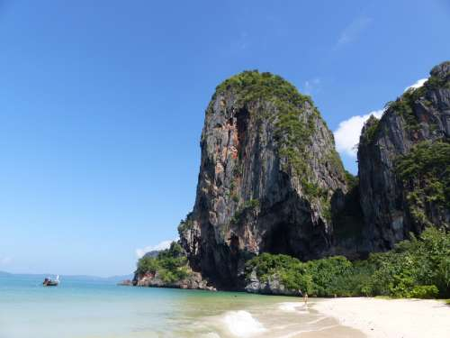 Shoreline and rock hill in Thailand free photo