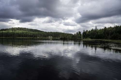 Shoreline, lake, and clouds in Algonquin Provincial Park, Ontario free photo