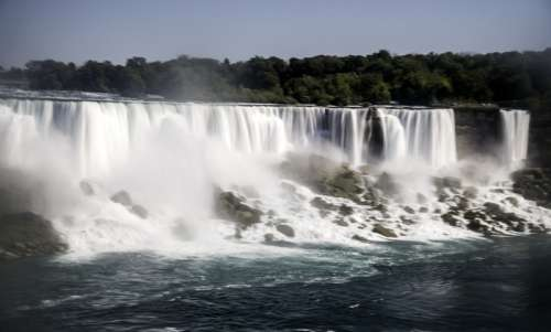 Silky Waters of American Falls Flowing down from the top as soon from Niagara Falls, Ontario, Canada free photo