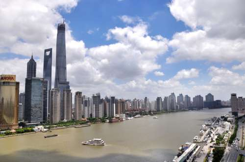 Skyline and Cityscape with the river and sky in Shanghai, China free photo