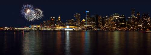 Skyline and fireworks at night in Vancouver, British Columbia, Canada free photo
