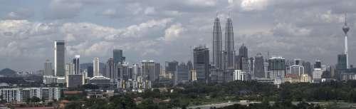 Skyline of Kuala Lumpur under the clouds in Malaysia free photo