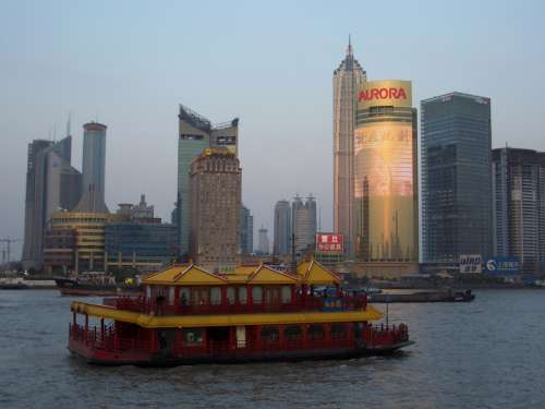 Skyline of Pudong, Shanghai, China behind a boat free photo