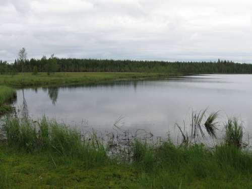 The small lake of Ahvenlampi in Puolanka, Finland free photo