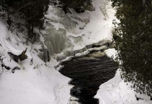 Small Pool beneath a waterfall in the winter as Cascade River State Park, Minnesota free photo