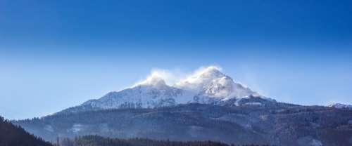 Snow capped mountain peaks in Steinbockweg Innsbruck, Austria free photo