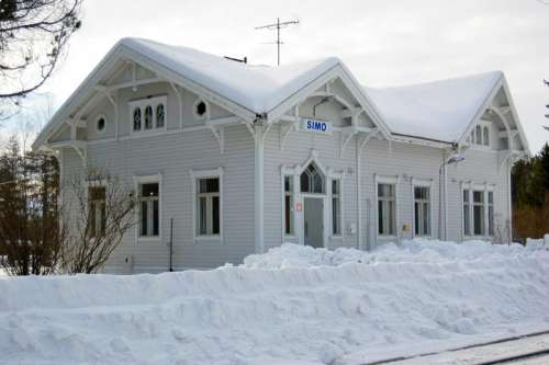 Snow covered railway station in Simo, Finland free photo