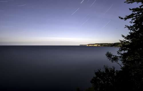 Star Trails above lake Superior at Pictured Rocks National Lakeshore, Michigan free photo