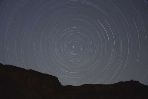 Star Trails Spinning at night free photo