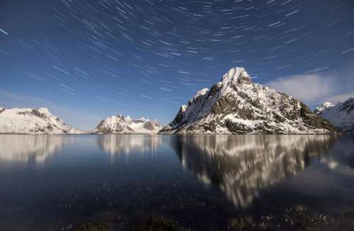 Star Trails with mountains and water in Norway free photo