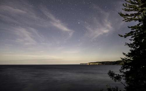 Stars above the night landscape at Pictured Rocks National Lakeshore, Michigan free photo