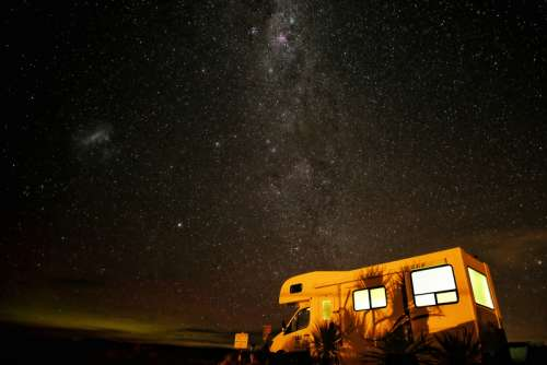 Stars and Milky Way above the trailer in Fortrose, New Zealand free photo
