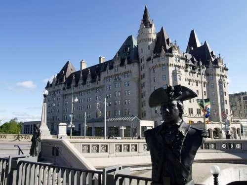 Statue and castle in Ottawa, Ontario, Canada free photo