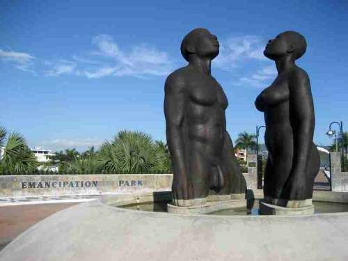 Statues of man and women in Kingston, Jamaica free photo