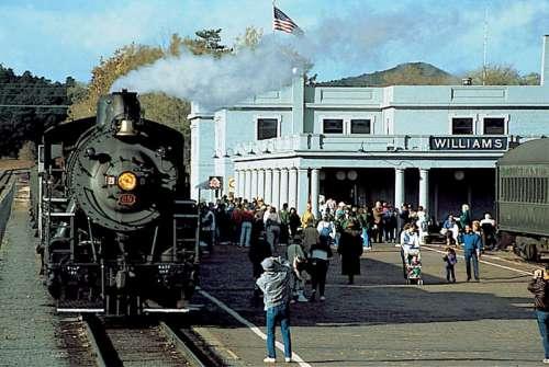 Steam locomotive and train sitting at Williams Depot in Arizona free photo