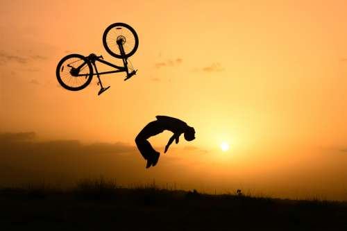 Stunt Cyclist at Sunset  free photo