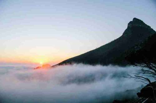 Sunrise above the clouds on the Mountain in Cape Town, South Africa free photo