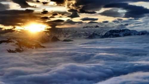 Sunrise at the Alps over a sea of clouds in Austria free photo